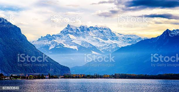 Switzerland Alps panorama at sunset from Lake Geneva, looking towards Villeneuve and Les dents blanches.