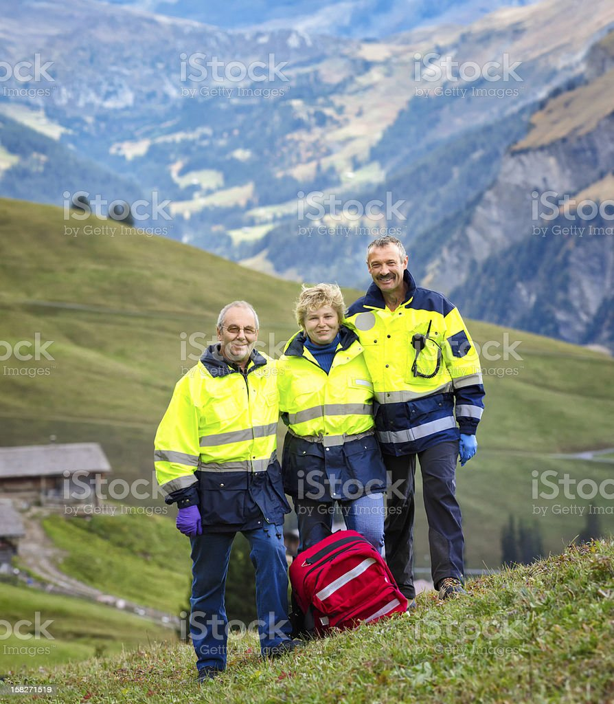 Switzerland Alps Paramedics Team Portrait Vertical royalty-free stock photo