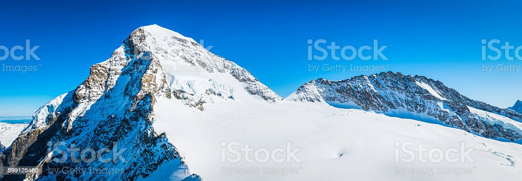 Switzerland Monch 4107m snowy mountain peak panorama Bernese Alps Jungfrau stock photo