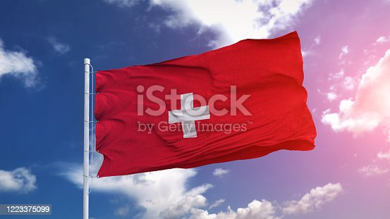 1125774238 istock photo Switzerland national flag waving on the blue sky with beautiful sunlight. 3d illustration 1223375099