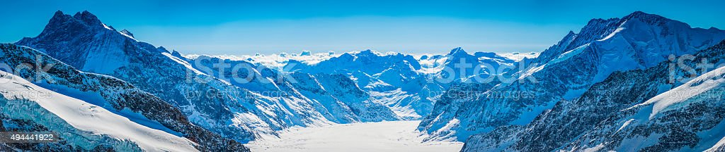 Switzerland panoramic view over Aletsch Glacier dramatic mountain peaks Alps stock photo