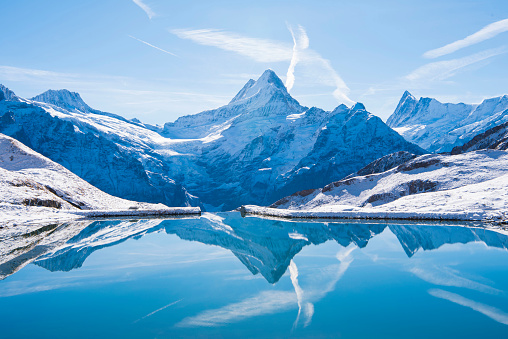 The Alps reflected in the snowy Bachalsee Lake.
