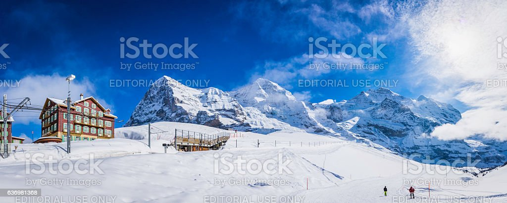 Switzerland skiers enjoying snow Kleine Scheidegg winter ski resort Alps stock photo
