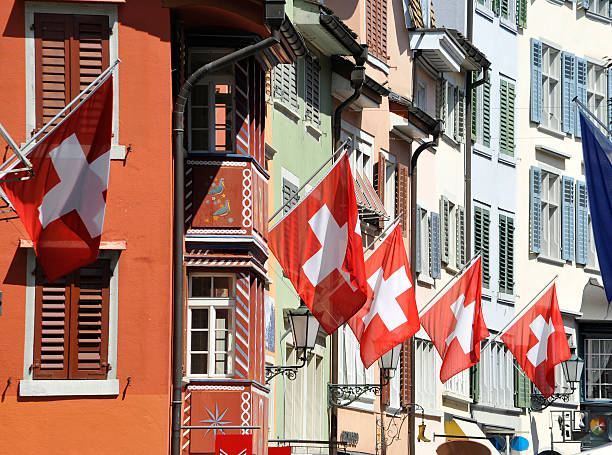 switzerland zurich city with flags on building facade  zurich stock pictures, royalty-free photos & images