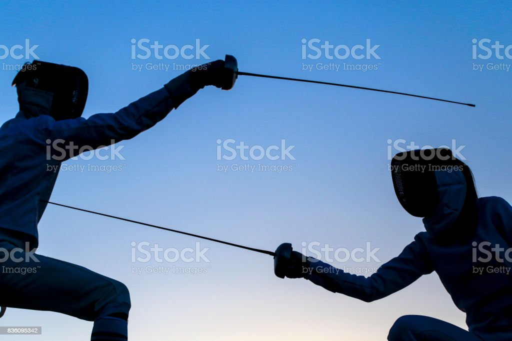 Sword Fighting Stock Photo & More Pictures of Adult | iStock