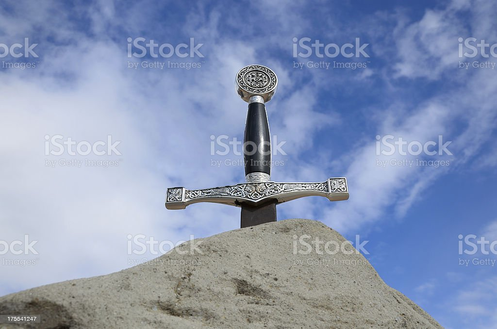Sword in stone against the sky stock photo