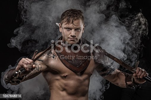 Sword wielding bloody viking warrior in emotional pose
