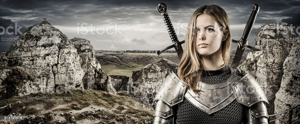 Sword Wielding Viking Warrior Young Blond Female In Wild Highland Countryside Royalty Free Stock Photo