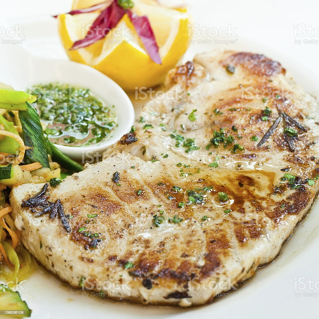 Sworfish steak with steamed vegetables and spices stock photo