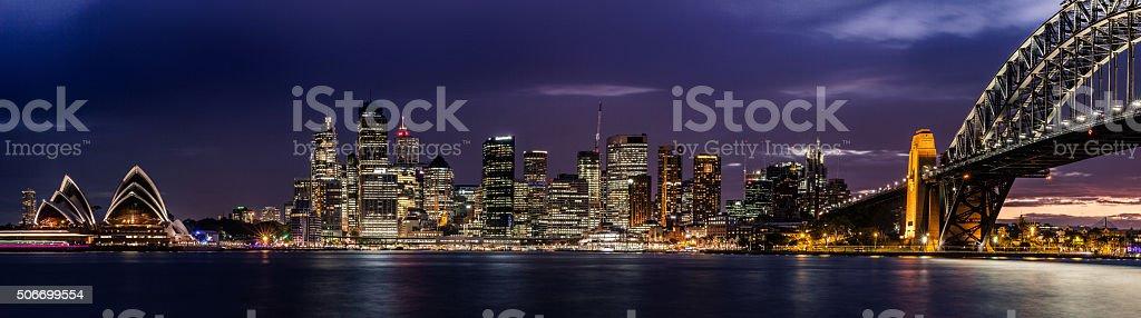 Sydney CBD and harbor illuminated at night stock photo