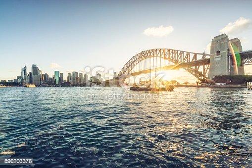 istock Sydney city skyline against sunset sky 896203376