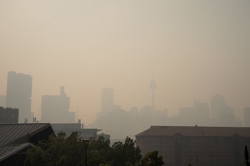Sydney, NSW - November 21st 2019: Sydney city skyline obscured by smoke from various bushfires across NSW. Taken from Pyrmont.