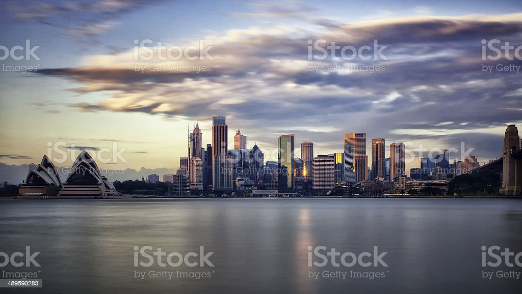 Sydney financial district and the Opera House at sunrise stock photo
