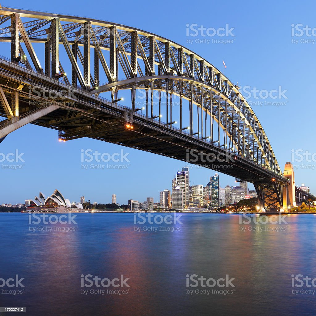 Sydney Harbor Bridge against skyline at night stock photo