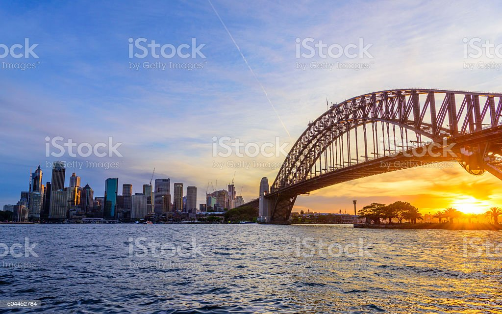 Sydney harbour and bridge at sunset stock photo