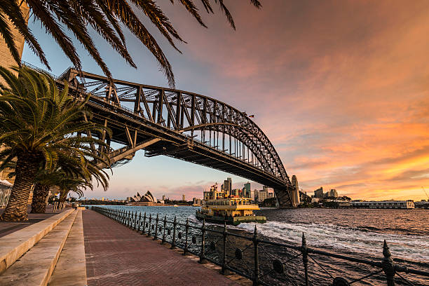 Sydney Harbour Bridge and Ferry at Dusk, Australia​​​ foto