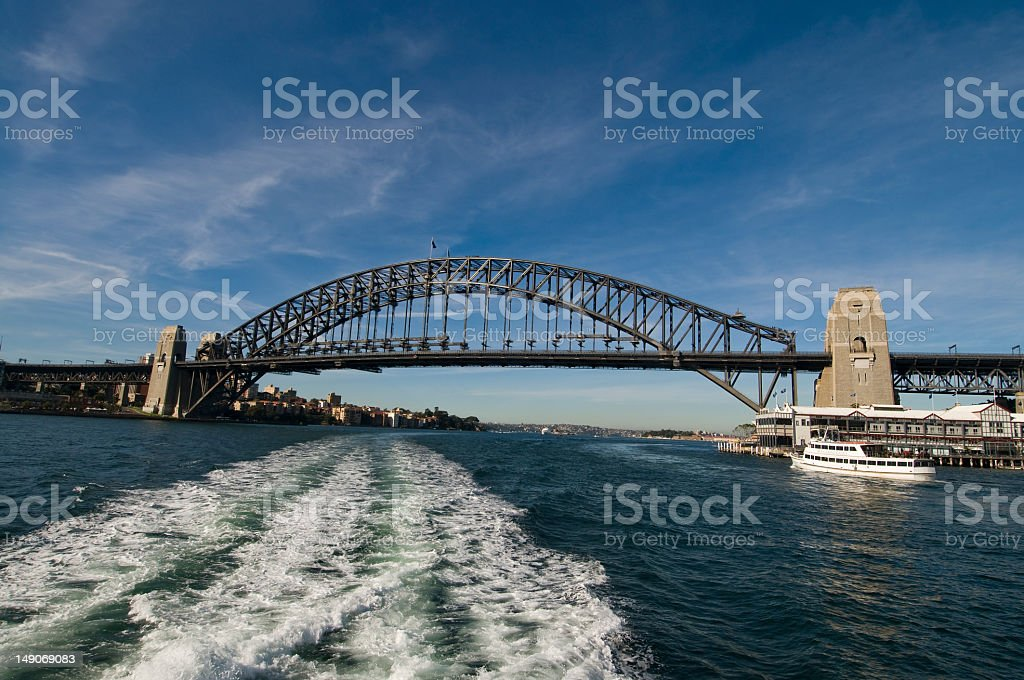 Sydney Harbour Bridge, Australia with Long, Wide Wake from Ferry royalty-free stock photo