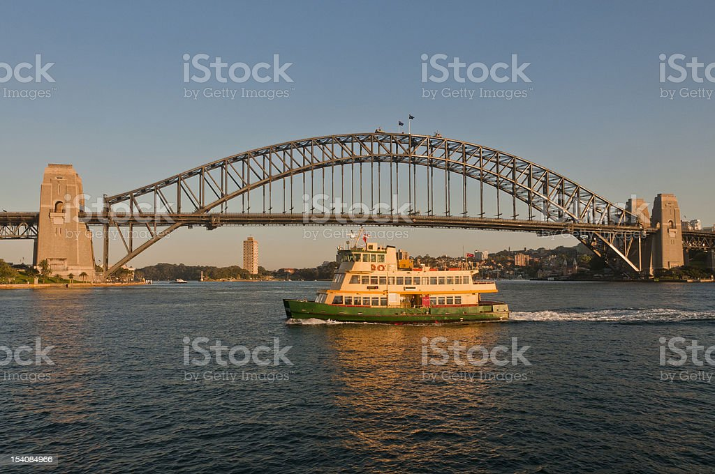 Sydney Harbour Bridge, ferry heading for Circular Quay, sunny morning royalty-free stock photo
