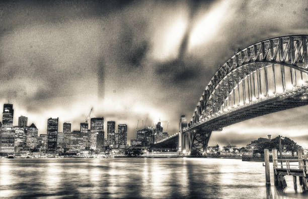 SYDNEY - OCTOBER 2015: Sydney Harbour Bridge. Sydney attracts 20 million tourists annually SYDNEY - OCTOBER 2015: Sydney Harbour Bridge. Sydney attracts 20 million tourists annually. annually stock pictures, royalty-free photos & images