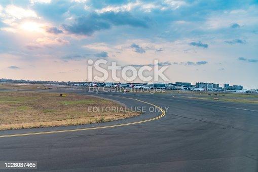 Sydney International Airport runway at dusk, New South Wales, Australia.