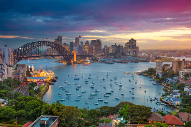Sydney. Cityscape image of Sydney, Australia with Harbour Bridge and Sydney skyline during sunset. australia stock pictures, royalty-free photos & images
