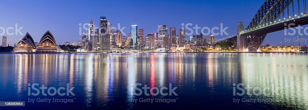 Sydney skyline lights make vertical reflections in water royalty-free stock photo