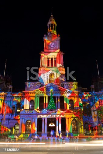 Sydney Town Hall is bathed in colourful projected lights as part of Christmas celebrations.
