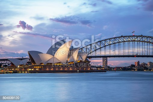 Sydney, NSW, Australia - November 2, 2015: Sydney Opera House and Sydney Harbour Bridge illuminated at dusk