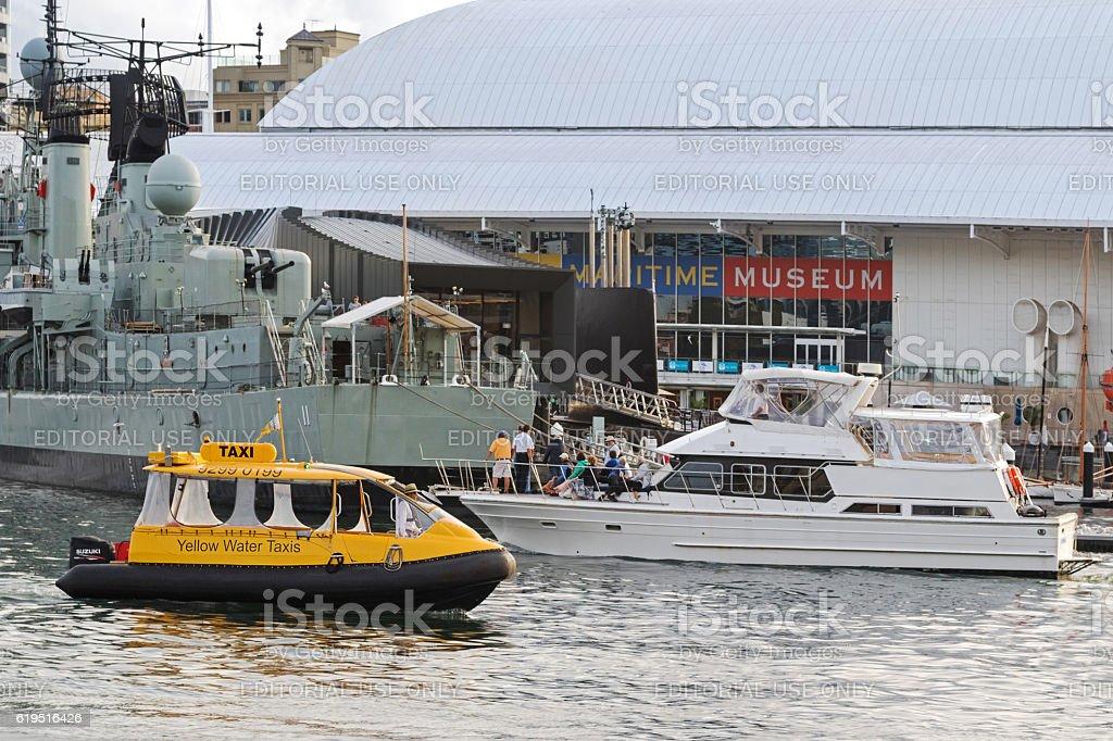 Sydney Yellow Water taxi passing yacht, Destroyer HMAS Vampire ship stock photo