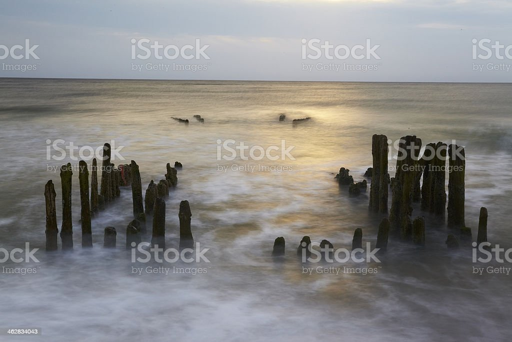 Sylt (Germany) - Groin in the sunset stock photo