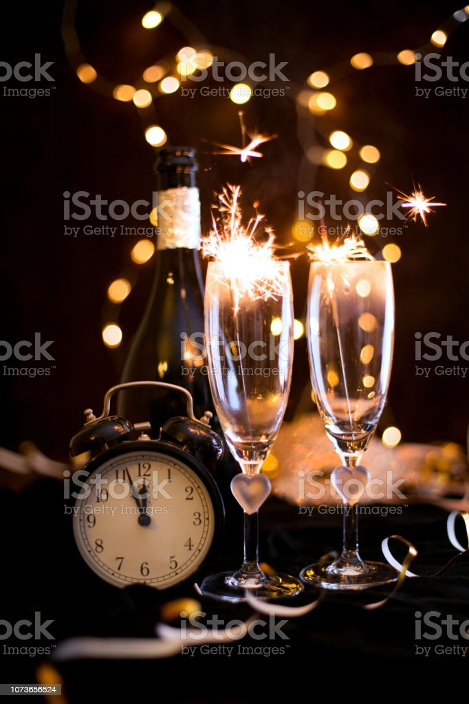 Sylwester, Andrzejki's toast for two. Champagne and fortune telling on a black background. Celebration, lights and new year stock photo
