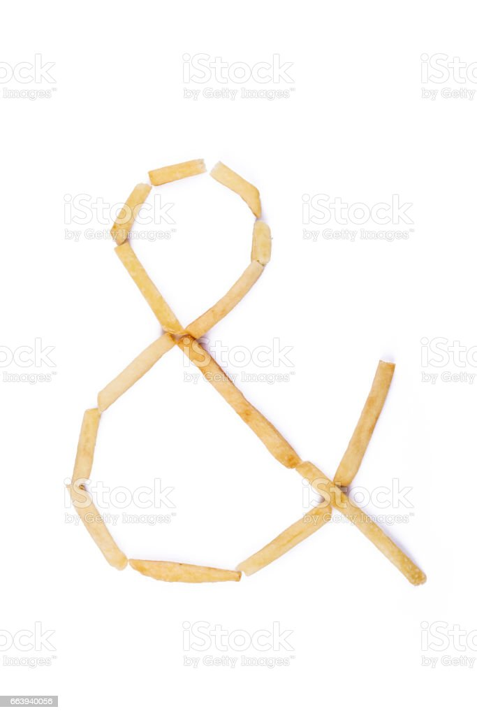 Symbol ampersand laid with french fries. stock photo