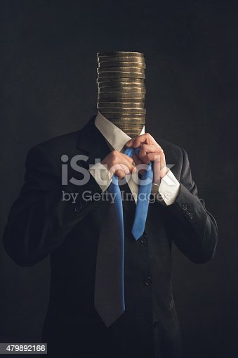 istock Symbol, Businessman with coins instead a head 479892166