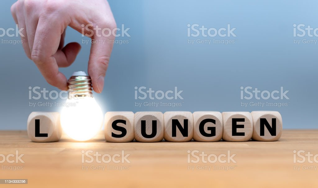 A Symbol for finding a solution. Dice and a light bulb form the...