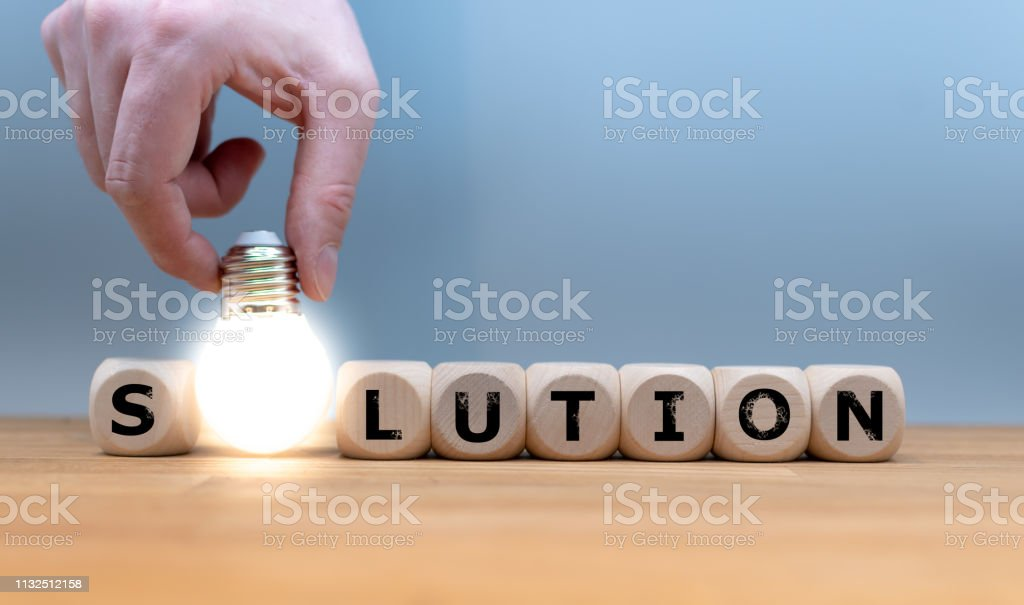 A Symbol for finding a solution. Dice and a light bulb form the word...