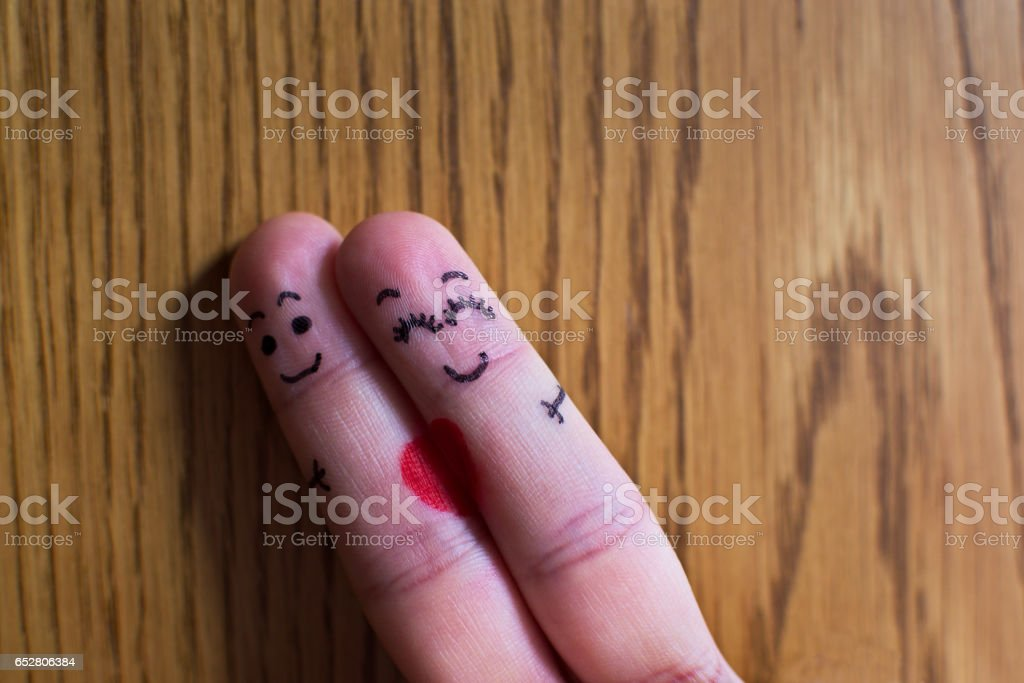 Symbol For Happy Couple In Love Two Fingers Hugging Stock Photo