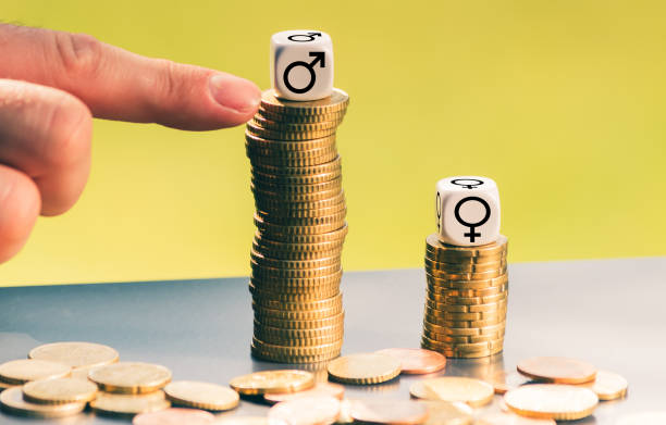 symbol for unequal payment. gender symbols on different high stacks of coins. - battle of the sexes concept stock pictures, royalty-free photos & images