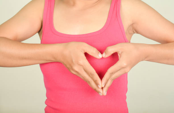 Symbol hand with heart woman   and Pink shirt stock photo
