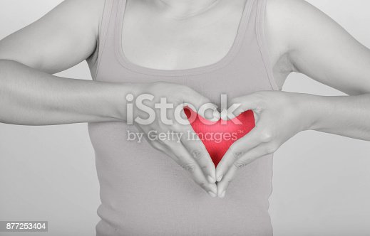 istock Symbol hand with heart woman and Pink shirt 877253404