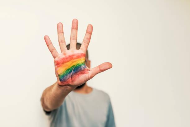 Symbole LGBT dans la paume de la main - Photo