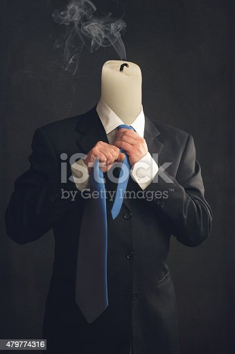 istock Symbol of a businessman with burnout syndrome 479774316