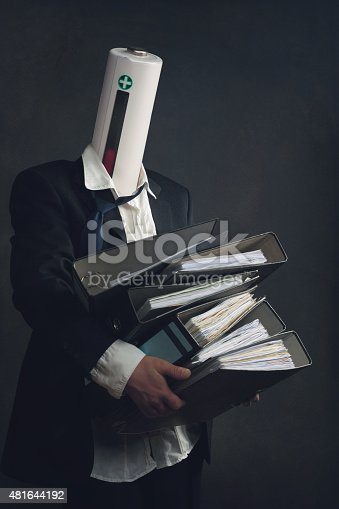 istock Symbol of a businessman with File Folders and burnout syndrome 481644192