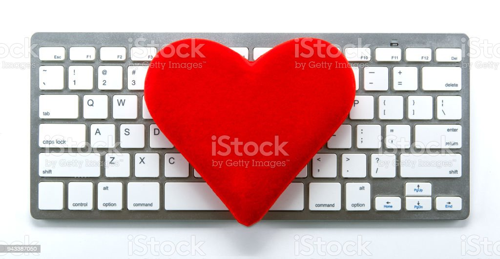 Symbol Of A Red Heart On The Keyboard As A Dating Symbol Closeup