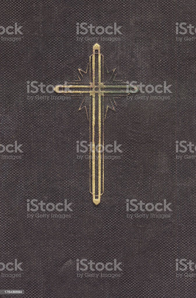 Symbol of Christianity: Golden cross on a prayer book royalty-free stock photo