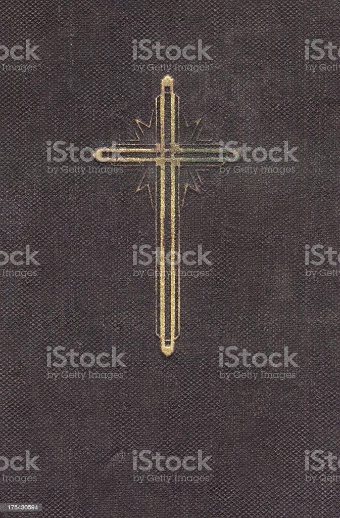 Symbol of Christianity: Golden cross on a prayer book stock photo