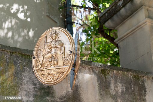 845085240istockphoto Symbol of french notary sign in street in France 1172688456