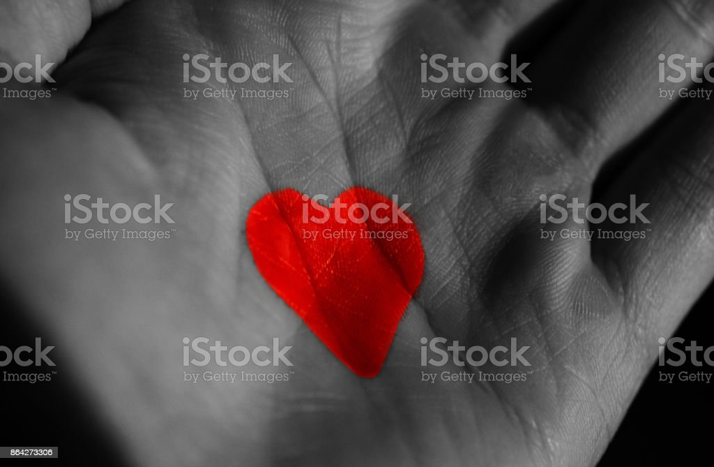symbol of love, icon of the heart drawn on the hand in the macro royalty-free stock photo