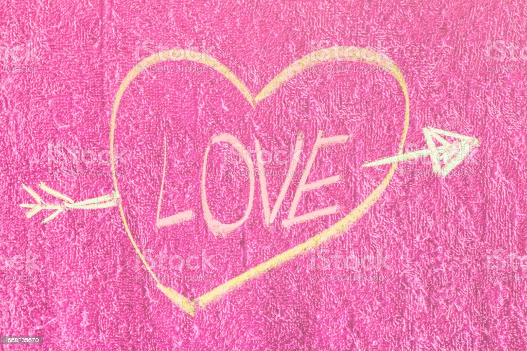 Symbol of love with chalk on Red bath towel background texture stock photo
