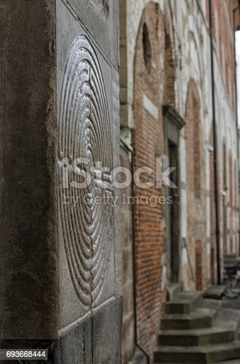 857874170 istock photo Symbol of maze engraved in the marble 693668444