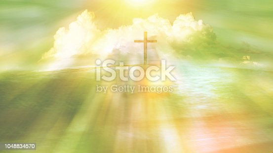 symbol of religious cross on a beach with sunlight ray and cloud